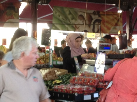 Customers being served at Victoria Market fruit and vegetable stall