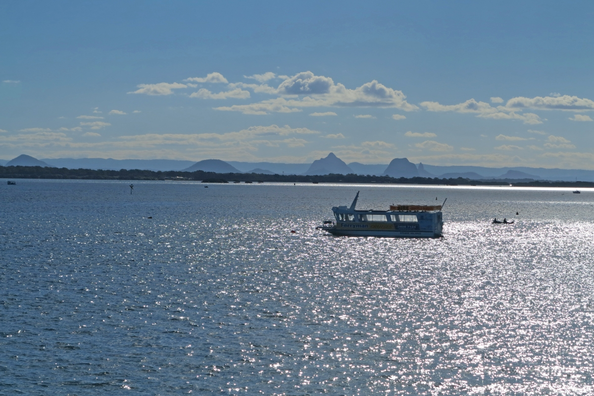 Sun on the water of Pumicestone Passage, looking over to Glass House Mountains