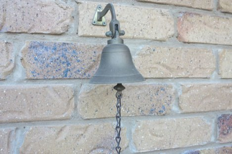 Bell on a brick wall