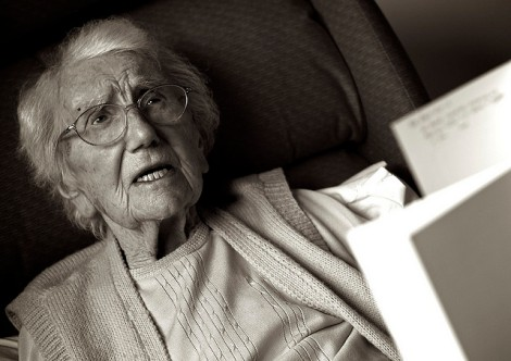 elderly woman with paperwork