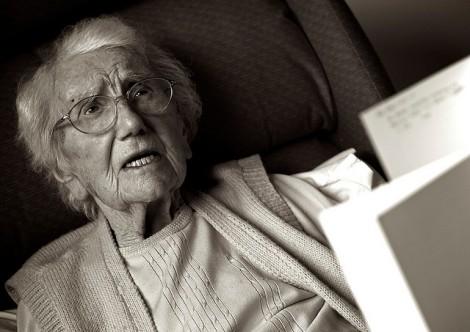 elderly woman with paperwork