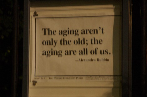 Saying on wall: The ageing aren't only the old; the ageing are all of us