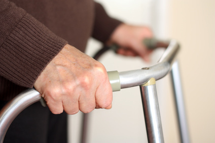 older person using walking frame