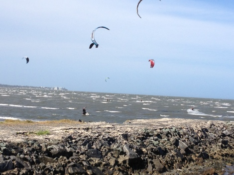 Kitesurfers ply the waters of Bramble Bay