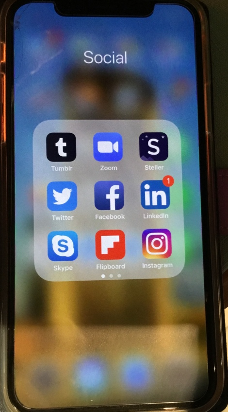 iPhone home page with social media icons showing